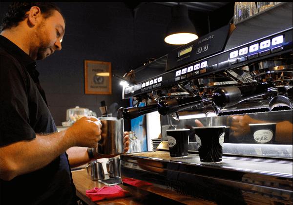 Man making coffee in an Australian Coffee School